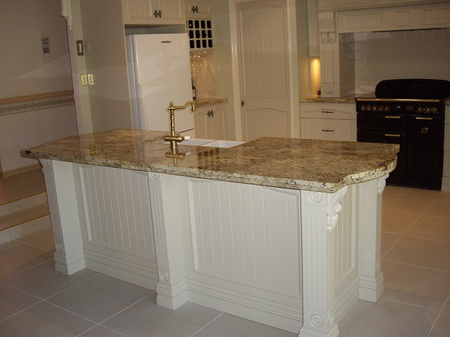 Image is of a Colonial nature with corbels and posts and butler sink and huge skirting.