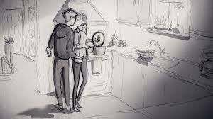 a happy loving couple kissing in  kitchen.