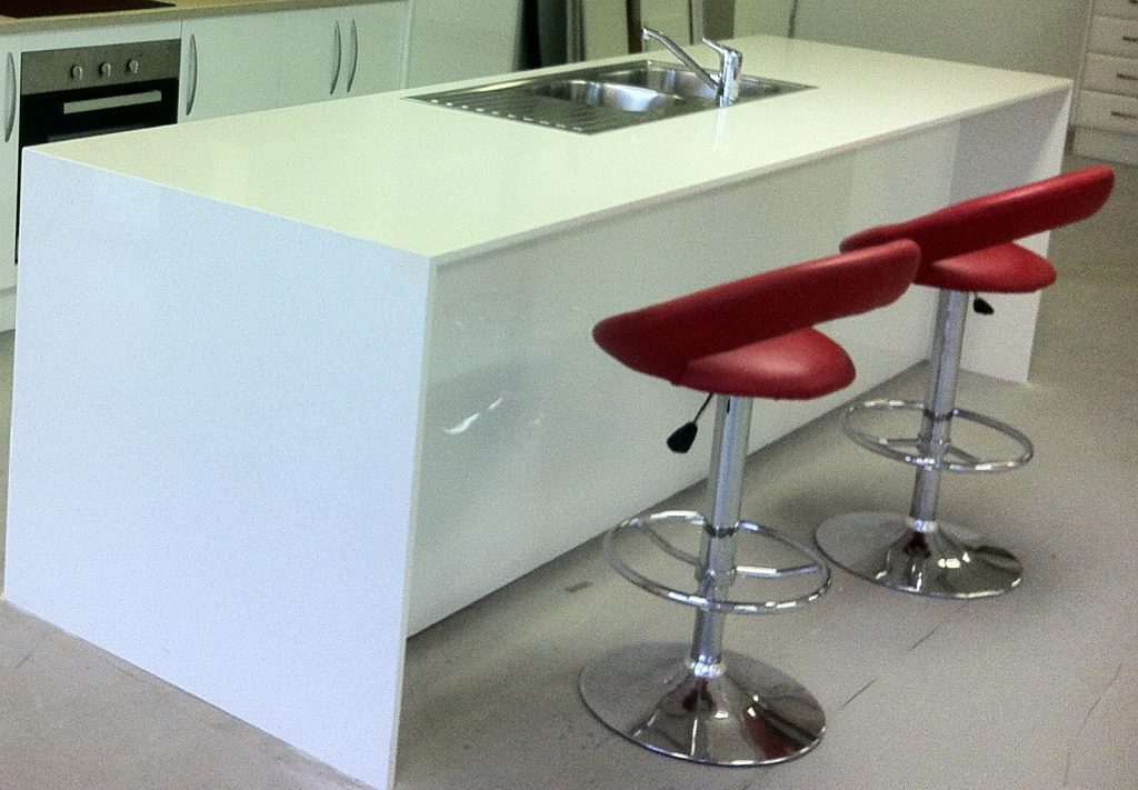The image displays 20 mm stone bench tops with waterfall ends