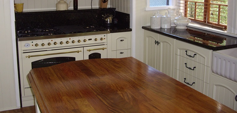 This is another image of a rosewood timber bench top on the island in conjunction with granite bench tops on the main tops.