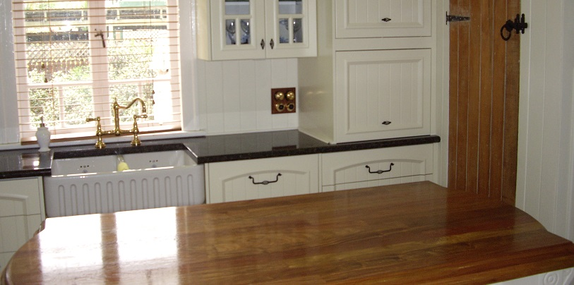 This image is of a rosewood timber bench top on the island in conjunction with granite bench tops on the main tops.